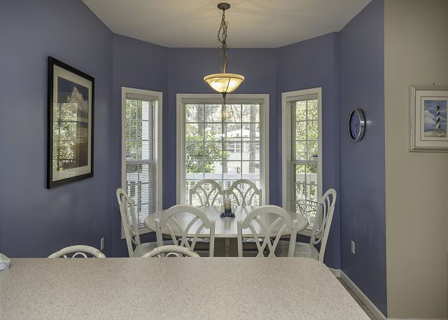 Bradley Beach 35, 4 Bedrooms Private Pool, Near Ocean, Sleeps 12 - Dine in a sunny corner, then linger for games and drinks! - HiltonHeadRentals.com