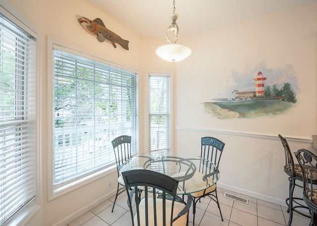 Bradley Beach 38, 4 Bedrooms Private Pool, Near Ocean, Sleeps 12 - Dine in a sunny corner, then linger for games and drinks! - HiltonHeadRentals.com