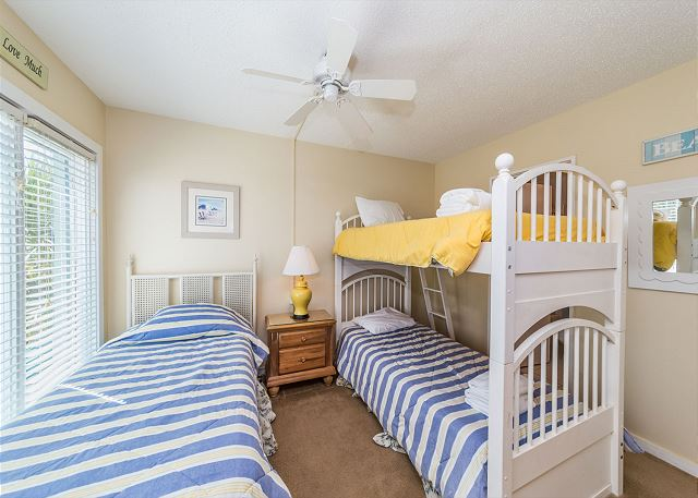 Kids and Adults Alike Will Love The Cheerful Second Bedroom!