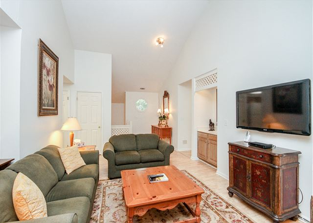 Evian 123, 2 Bedrooms, Lagoon View, Pool, Sleeps 6 - Living Room - HiltonHeadRentals.com