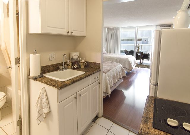 Kitchenette in Waikiki Studio with 2 full Beds
