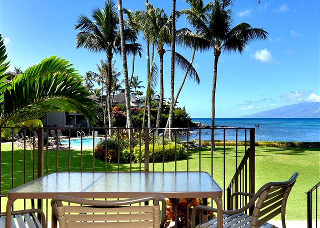 The #114 lanai opens to the pool & Honokeana Cove, with Molokai beyond