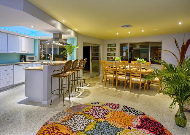 8 person dining available with views of the lanai and pool.