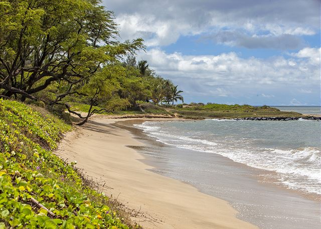 Waiohuli Beach Hale is situated on a white sandy beach.