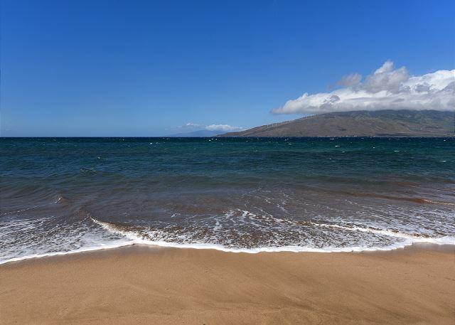 White sandy beach across the street from Kihei Bay Vista.