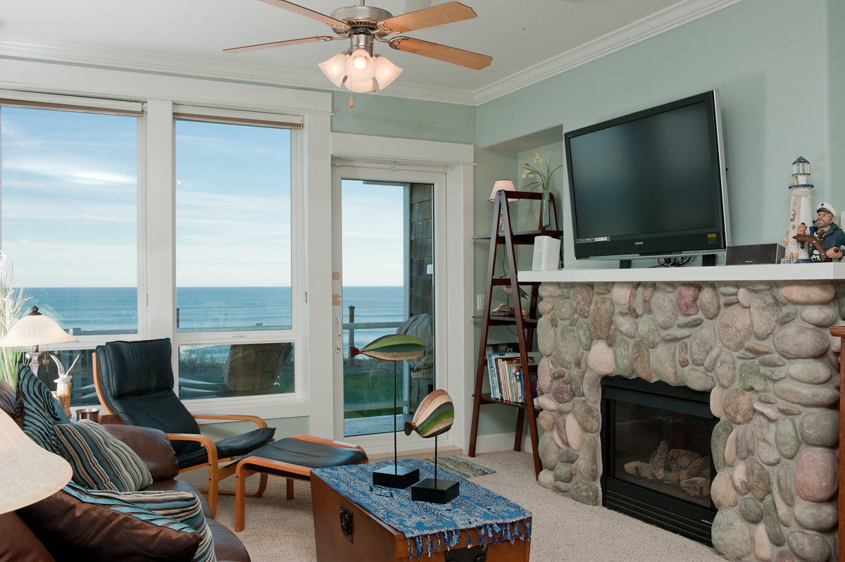 Relax In Comfortable Elegance With A Plasma TV And River Rock Fireplace