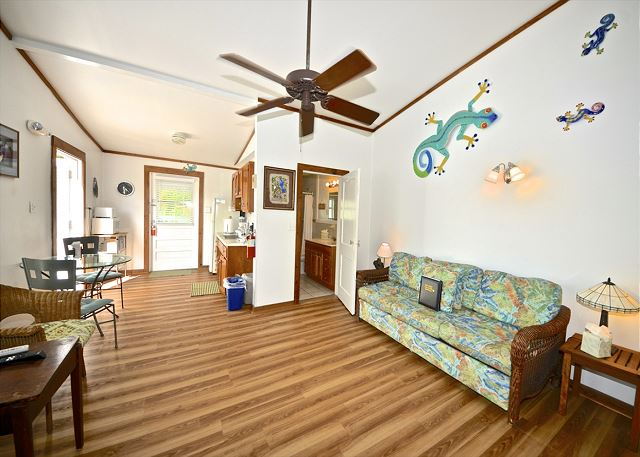 Inside, You Will Find This Spacious Living AreaComplete With a Ceiling Fan and Tropical Decor
