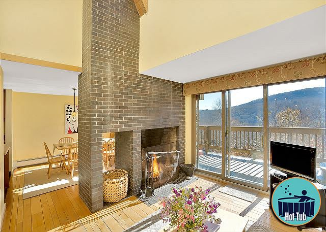 <center>Beautiful views from living/dining rooms.  Cozy wood burning fireplace for the perfect Ambiance<center>.