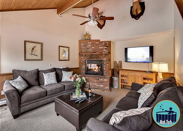 Large open living room, flat screen TV, and wood burning fire place for the getaway you have been looking for