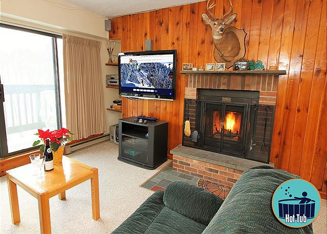 Living room with 46 inch flat screen TV and wood burning fireplace creates a space you won't ever want to leave