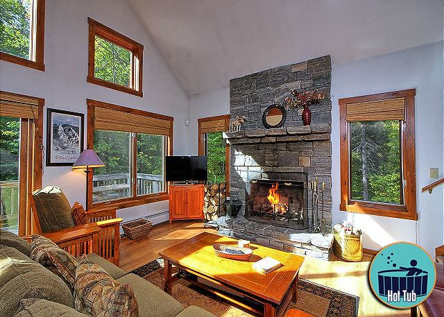 <center>Beautiful fireplace and  large windows filtering in natural light provides the getaway you have been searching for  <center>