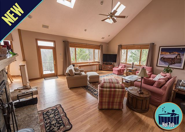 Enjoy the bright and spacious living room with a wood burning fireplace.