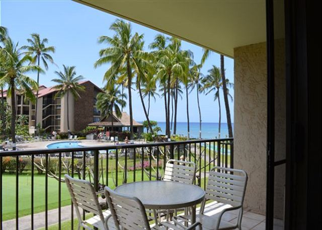 Lanai with a view of the pool and ocean