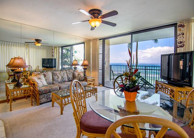 As you can see the living room and dining room area is carpeted.  Living room provides a lovely view of the ocean