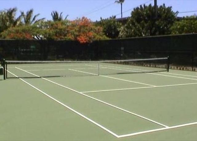 Tennis court, tropical landscape throughout the complex