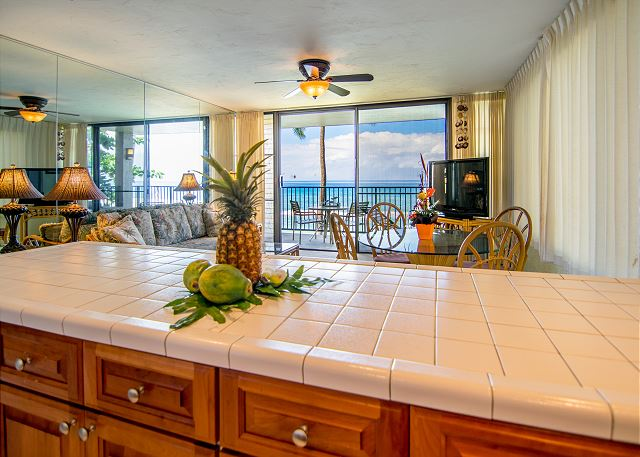 View from kitchen through living/diving area to the lanai and the ocean