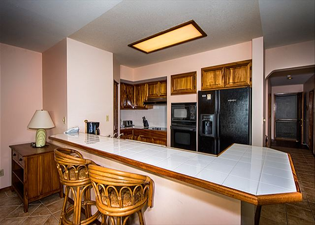 Fully Equipped Kitchen with Bar area, and bar stools!