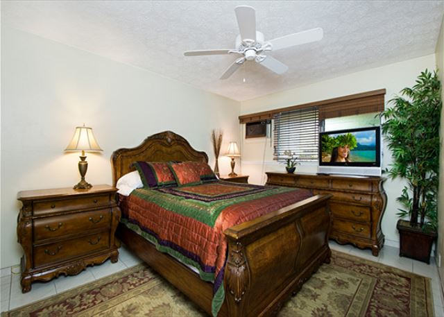 Master bedroom upstairs! Queen Sized bed. Has TV & AC unit!