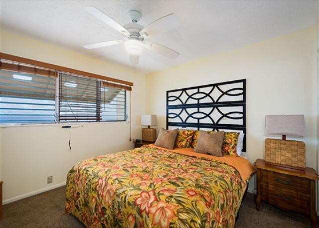 Master bedroom features a king sized bed! And has a view towards the ocean!