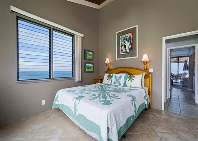 This bedroom has a great King Sized bed featuring ocean views & golf course views! The most private feeling!