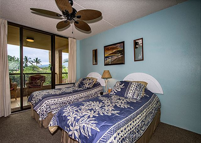The 2nd bedroom has 2 twin beds. All bedrooms open up to the lanai!