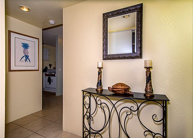 Upon walking through the front door, you can turn left into the living room, or right towards the bedrooms