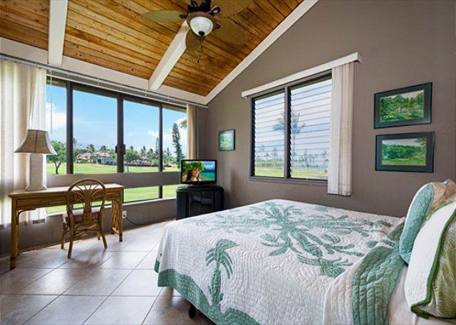 One of the 3 bedrooms. This is downstairs. Golf course & Ocean views!
