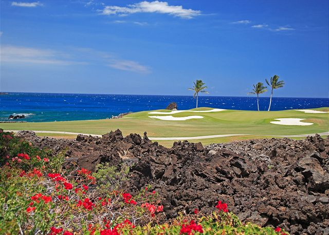 Beautiful contrast of flower's, lava, signature golf hole, and the pacific ocean. Just a short walk to the private sandy bay