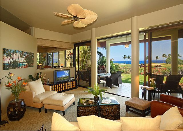 Living room with sweeping signature golf hole and ocean views