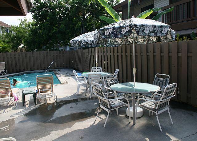 Pool deck and umbrella tables