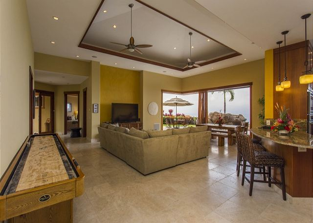 Main Living Area with a Shuffleboard Table