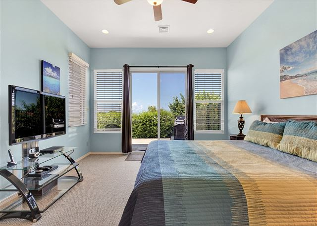 Master Bedroom with King Bed and Large Flat Screen TV