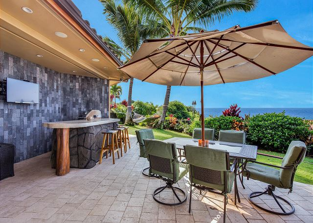 Outdoor Dining and Grill Area with Flat Screen TV