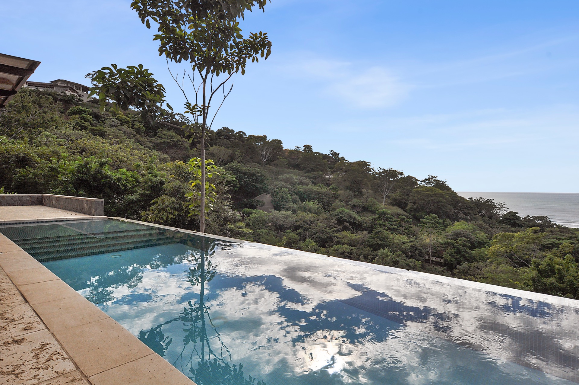 Our fantastic infinity pool overlooks all of Playa Tamarindo and