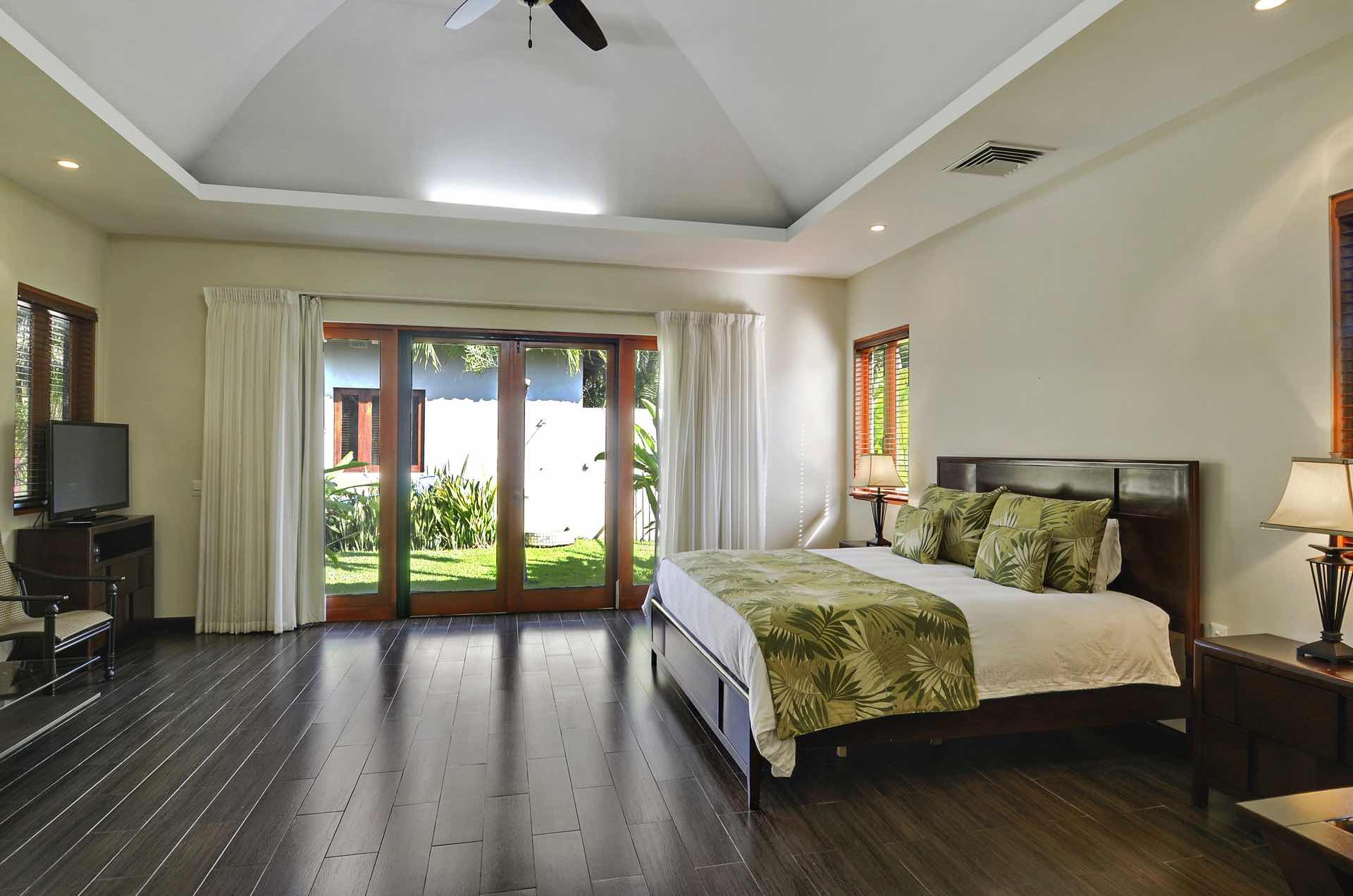 Master bedroom with access to pool and TV