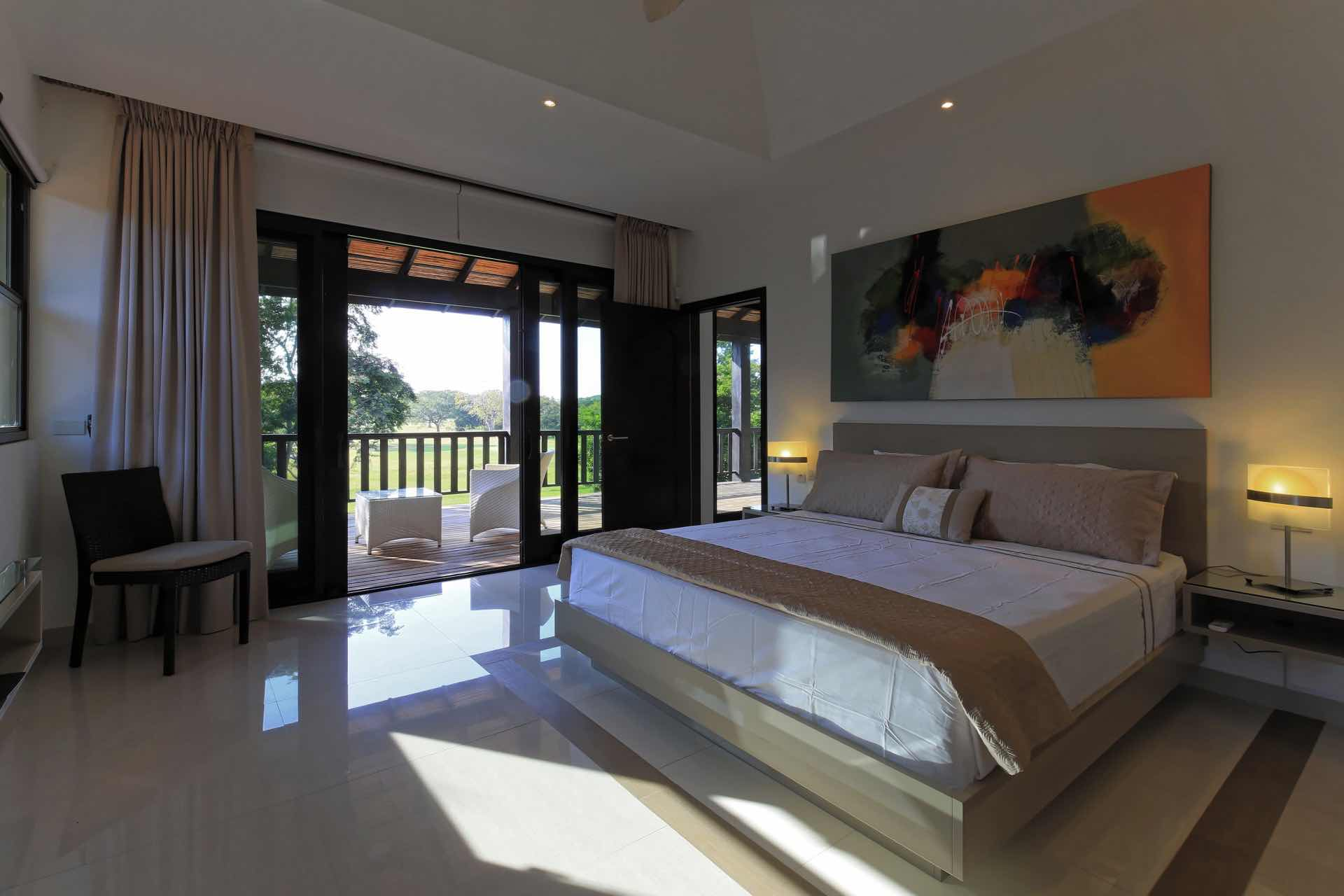 master suite opens to balcony and overlooks golf course
