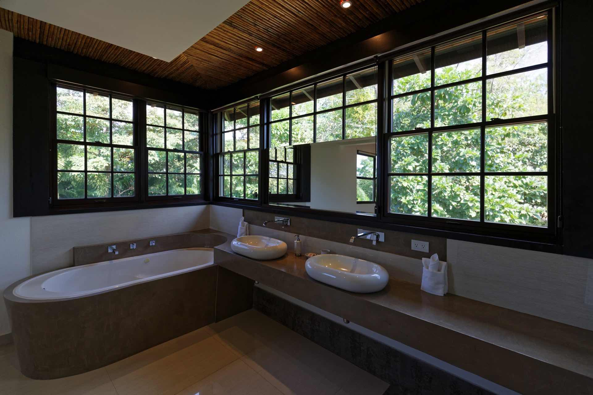 Spacious master bathroom with two sinks and tub