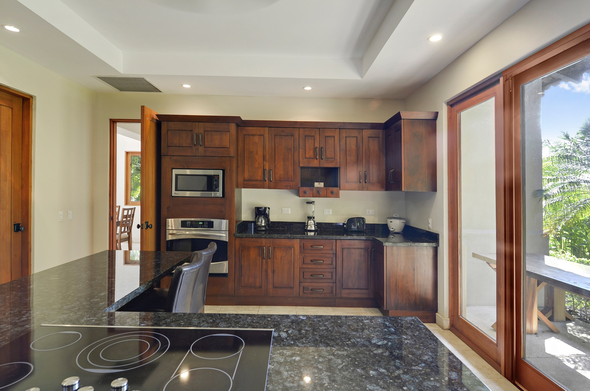 Kitchen with granite counter-tops and steel appliances
