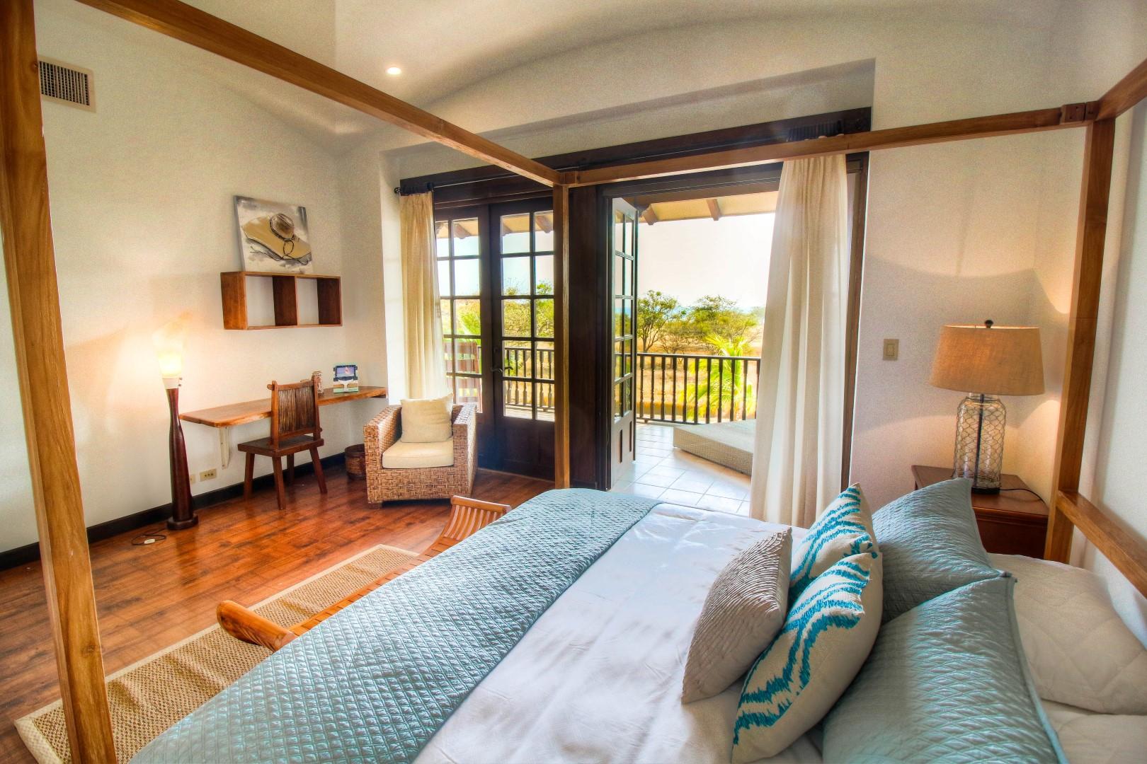 Master bedroom opens to ocean view balcony
