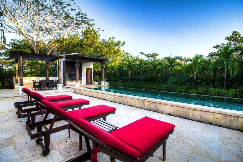 Infinity pool with lounge chairs