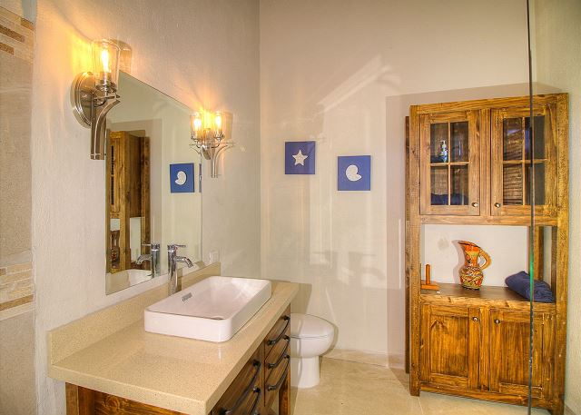 Rustic furniture accents the bathrooms