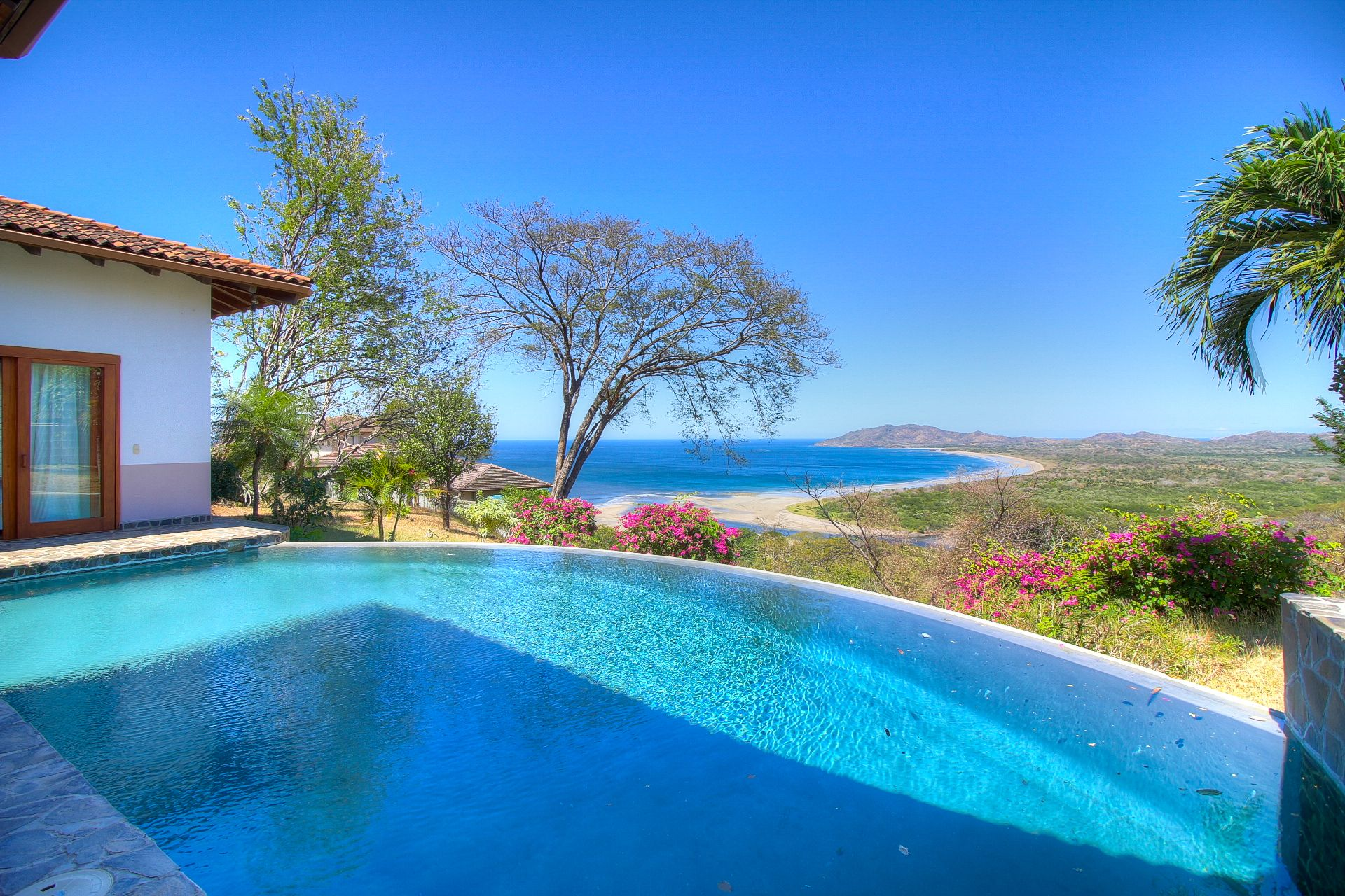 Infinity pool and panoramic view of Tamarindo Bay