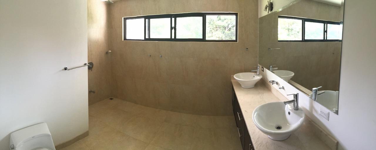 Spacious modern bathrooms