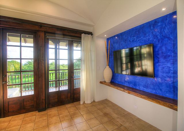 Large flat screen television in tv lounge