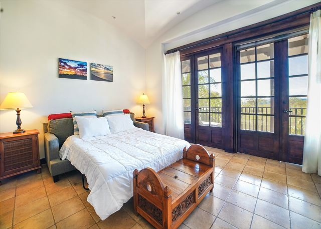 Ample guest suite with a small balcony