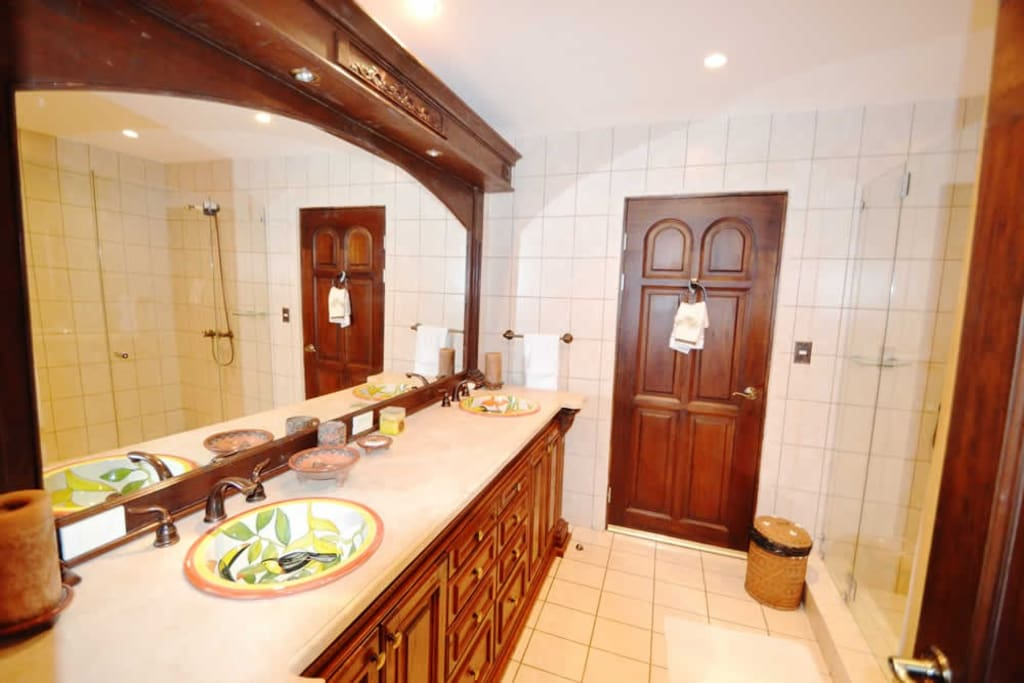 Bathroom with two sinks and shower