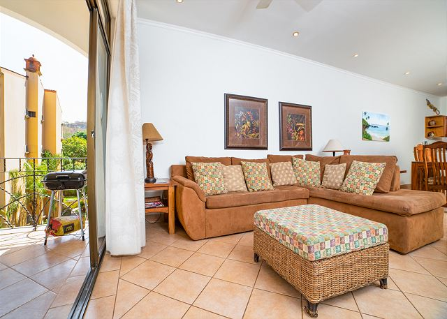 The living room is steps from the gorgeous balcony