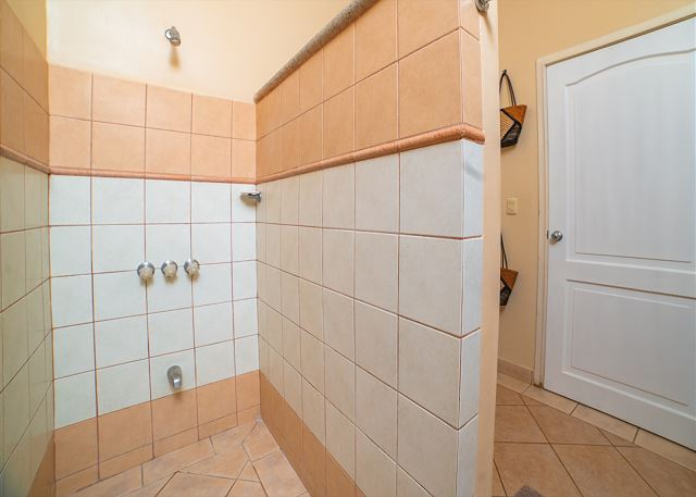 The spacious shower in the bathroom