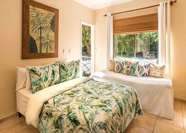 Guest bedroom with tropical theme