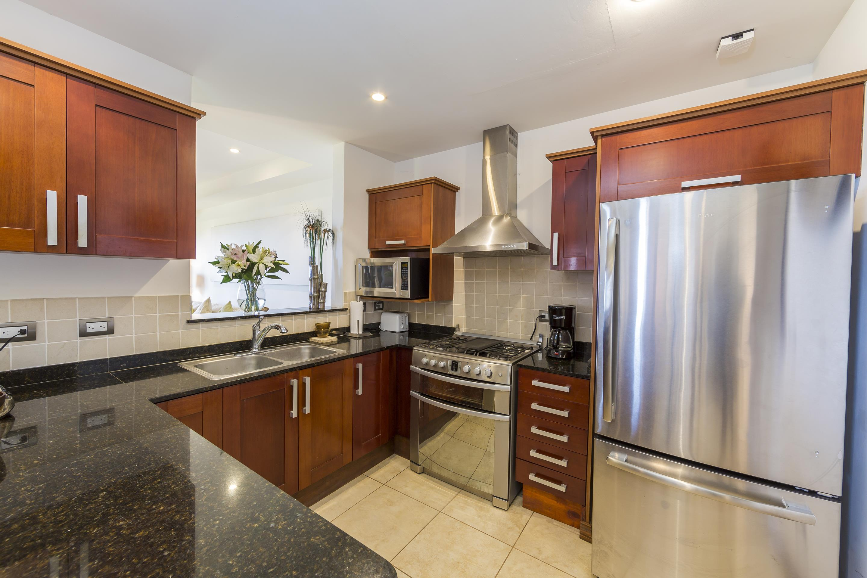 Granite counter tops and natural wood cabinets